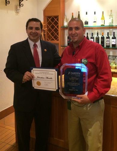 Congressman Cuellar Presents High Achieving Award to Laredo Olive